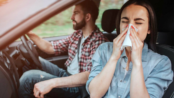 woman-passenger-is-sneezing-into-tissue-paper